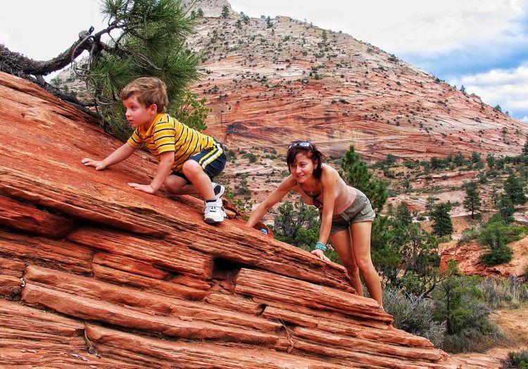 Child climbing on rock