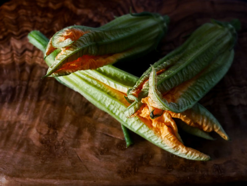 Courgette Flower Close-up Focus On Foreground Food Food And Drink Freshness Fruit Green Color Healthy Eating High Angle View Indoors  Leaf Nature No People Plant Part Selective Focus Still Life Table Vegetable Wellbeing Wood - Material