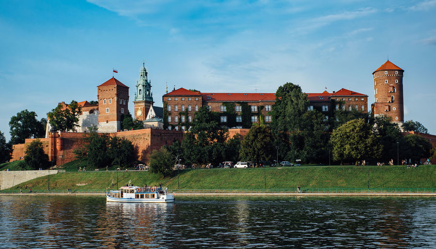 The Wawel castle in Krakow, Poland, in the foreground the Vistula river. Poland Wawel  Architecture Building Building Exterior Built Structure Day History Krakow Mode Of Transportation Nature Nautical Vessel Outdoors Plant Sky Transportation Travel Travel Destinations Tree Water Waterfront