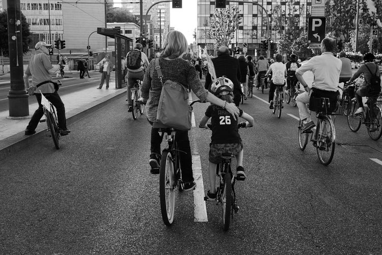CyclingUnites City Transportation City Life Women Outdoors Black & White Black And White Blackandwhite Streetphoto_bw Street Photography Streetphotography Child City City Life Women Adult People Large Group Of People Outdoors Day Cycling Bicycle Urbanphotography Embrace Urban Life