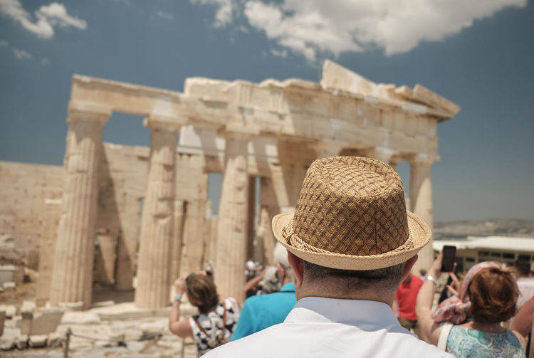 Looking Column Pillars Outdoors Elderly Hat 70s Senior Greece Older  Grey Archaeological Retirement Retire Outside Ancient Male Adult Europe Brochure Map Together Site Turkey Travel Retired Man 80s Mature Caucasian People Ruins Attractions Active Happy Hair Tourist Pointing Athens Old person