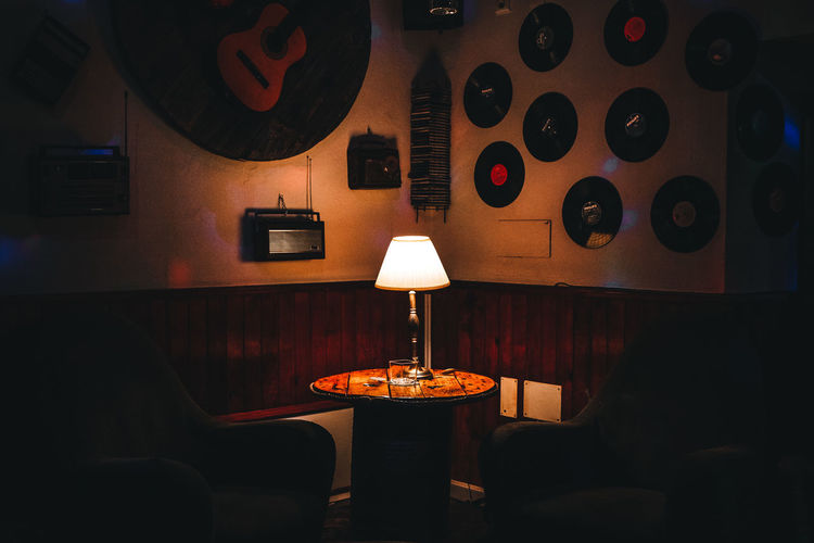 Illuminated electric lamp on table in restaurant