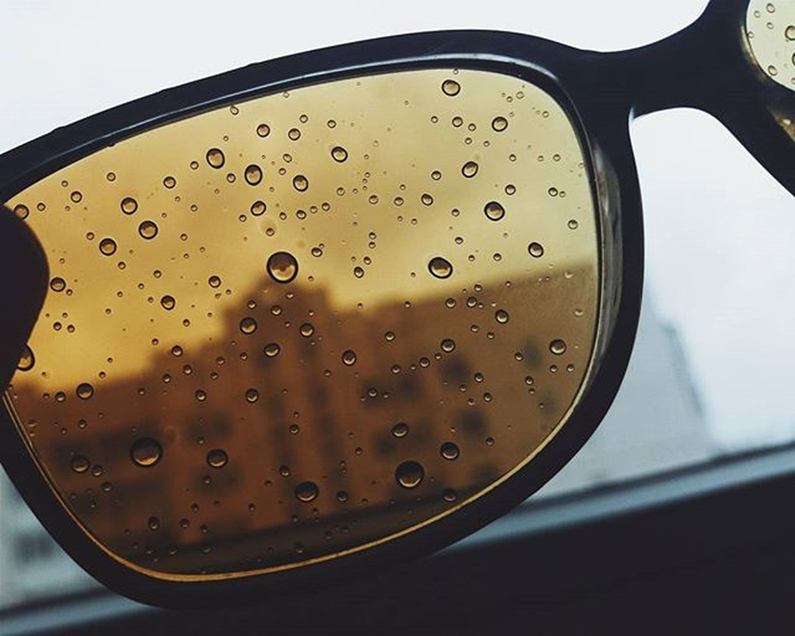 glass - material, transparent, drop, window, close-up, indoors, transportation, wet, vehicle interior, water, mode of transport, car, rain, focus on foreground, part of, car interior, side-view mirror, glass, land vehicle, sky