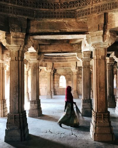 Woman walking in historical building