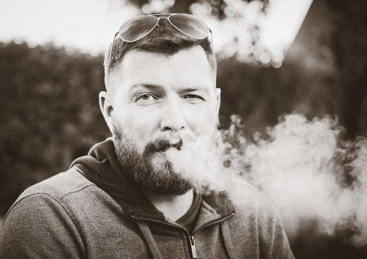 Portrait Of Man Smoking Outdoors