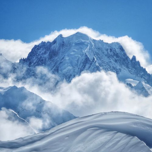 Frozen Nature Cold Shrouded Clouded Pristine Majestic Nature Landscape Snow Mountain White Color Cold Temperature Winter Scenics Nature Beauty In Nature Snowcapped Mountain Sky Day Mountain Range No People Tranquility Outdoors Blue