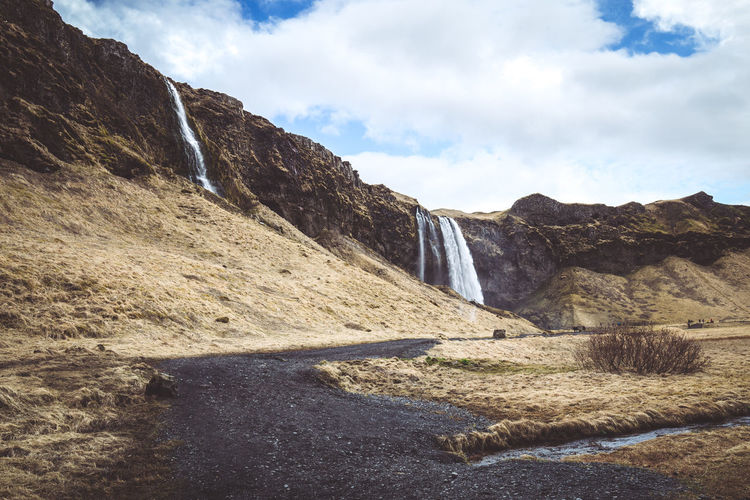 Days of travel: 6 - Seljalandsfoss Iceland Beauty In Nature Cloud - Sky Day Environment Flowing Flowing Water Formation Land Landscape Mountain Mountain Range Nature No People Non-urban Scene Outdoors Rock Rock - Object Rock Formation Scenics - Nature Sky Solid Tranquil Scene Tranquility Water The Great Outdoors - 2018 EyeEm Awards