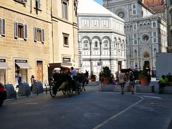 Italy Ancient Ancient Wall Ancient Architecture Community Outreach Community Urban City Florence Florence Italy Firenze Duomo Di Firenze Street Streetphotography City Men Politics And Government Women Sitting Sky Architecture Building Exterior Built Structure Side-view Mirror King - Royal Person Horsedrawn Horse Cart Carriage Palace Historic