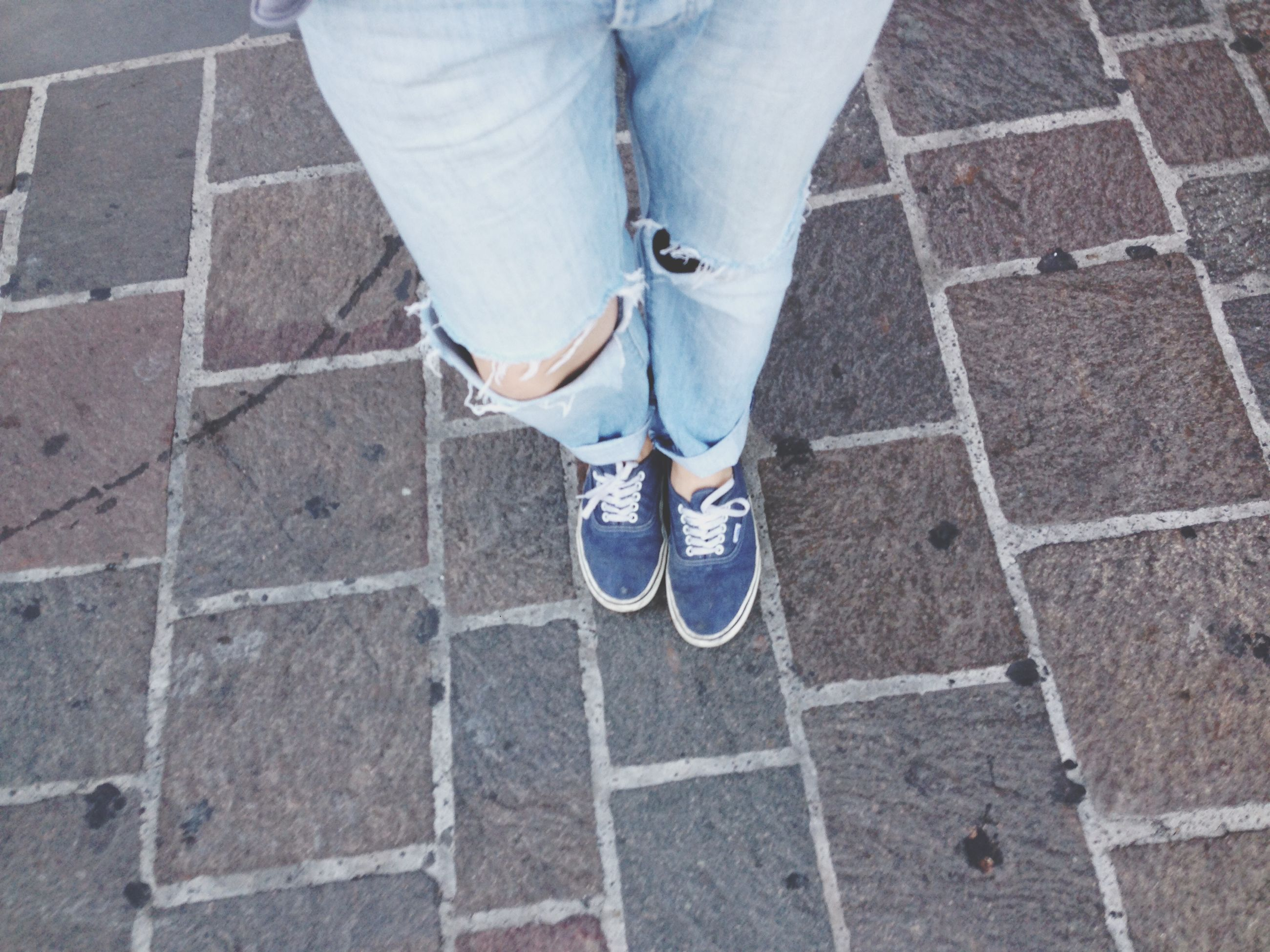 low section, person, shoe, lifestyles, street, standing, high angle view, casual clothing, leisure activity, men, jeans, sidewalk, footwear, human foot, footpath, day