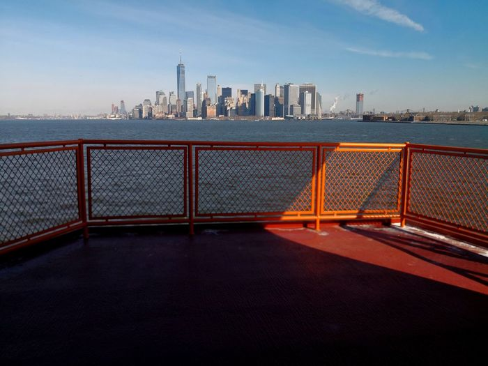 Mobilephotography Urban Followme New York Staten Island Ferry Sea Business Finance And Industry City Downtown District Water Urban Skyline Cityscape Skyscraper Sky Outdoors No People Beach Horizon Over Water Architecture An Eye For Travel Stories From The City