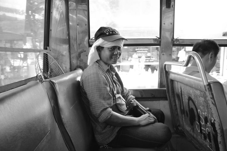Thailand Bus Mode Of Transportation Transportation Sitting One Person Hat Leisure Activity Lifestyles Casual Clothing Vehicle Interior Young Adult Travel Real People Clothing Public Transportation Day Window Outdoors