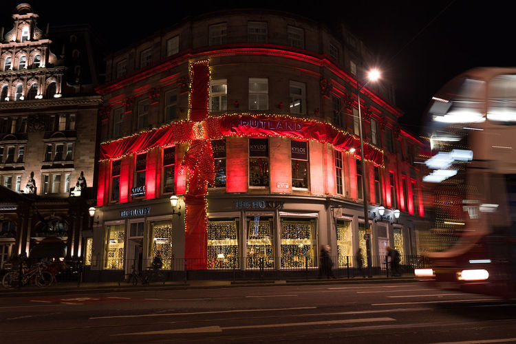 The Rutland Luxury Hotel in Edinburgh decorated as a present at Christmas time. Edinburgh Lights Motion Blur Architecture Blurred Motion Building Exterior Built Structure Christmas Decoration Christmas Present City Illuminated Illumination Landmark Night No People Outdoors Red Red Bow Red Ribbon Rutland Hotel The Rutland Hotel