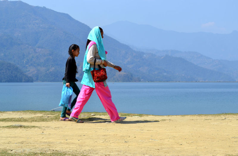 walking by the Phewa Lake Two People A Mother And Her Child Local People Pokhara, Nepal