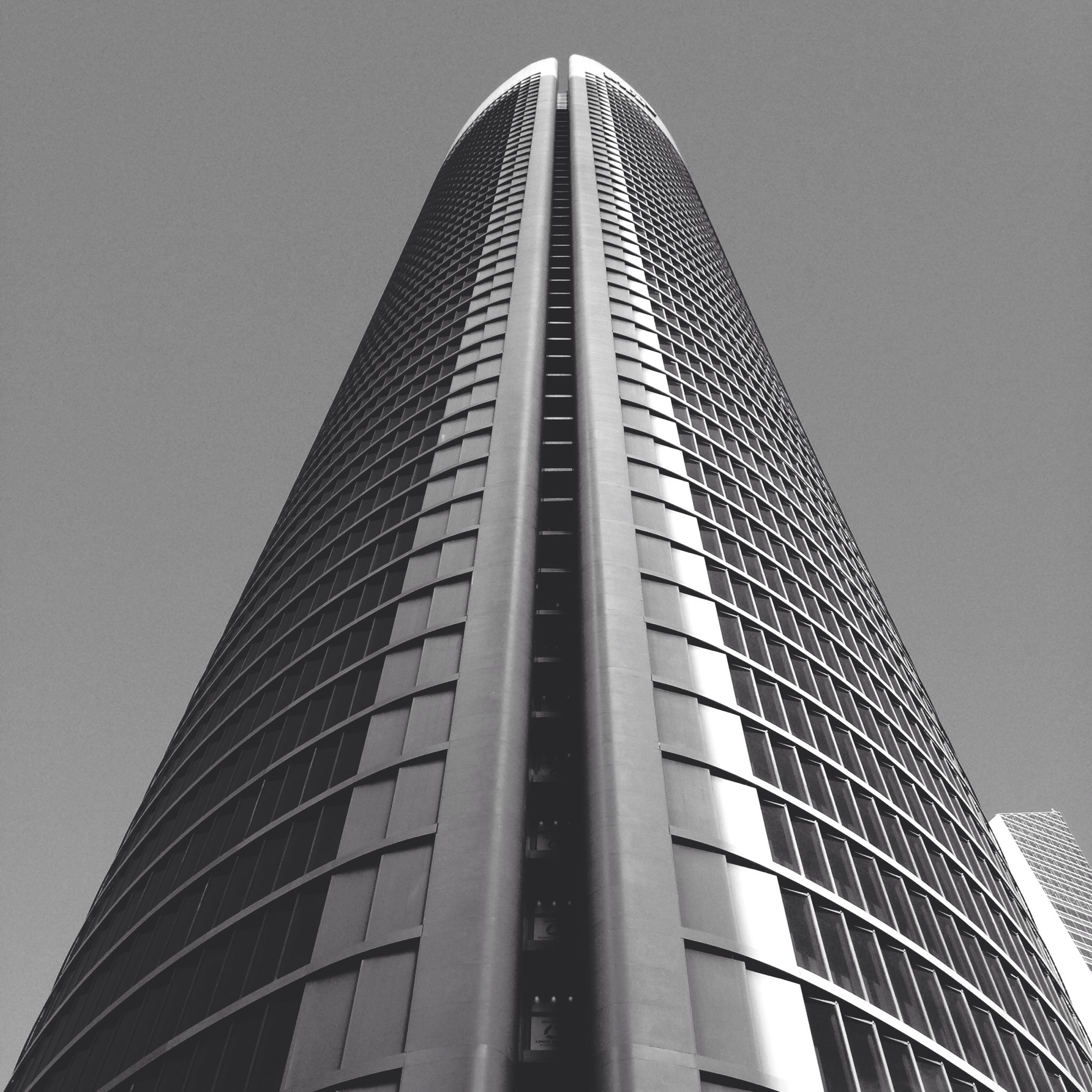 low angle view, architecture, built structure, building exterior, modern, tall - high, skyscraper, office building, tower, city, tall, clear sky, building, glass - material, sky, day, outdoors, no people, diminishing perspective, reflection
