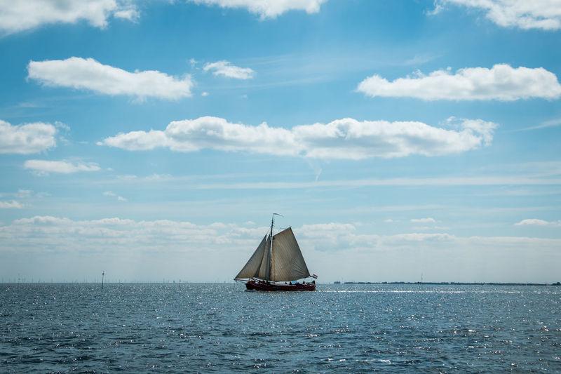 Sailboat On Seascape Against Sky