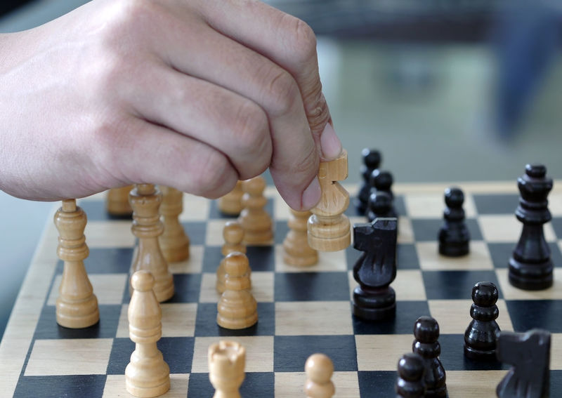 chess Board Game Chess Chess Board Chess Piece Close-up Day Focus On Foreground Human Body Part Human Hand Indoors  Intelligence King - Chess Piece Knight - Chess Piece Leisure Activity Leisure Games One Person Pawn - Chess Piece People Playing Queen - Chess Piece Real People Strategy