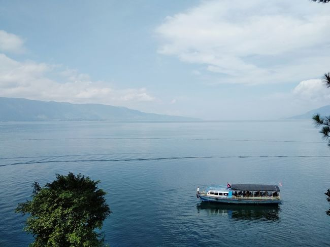 let the water decide. Toba Lake Ship Blue Sky Streetphotography Amateurphotography Nature Horizon Over Water