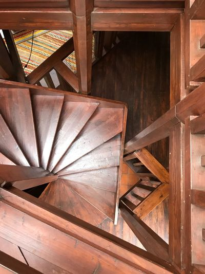 High angle view of wooden steps in old building