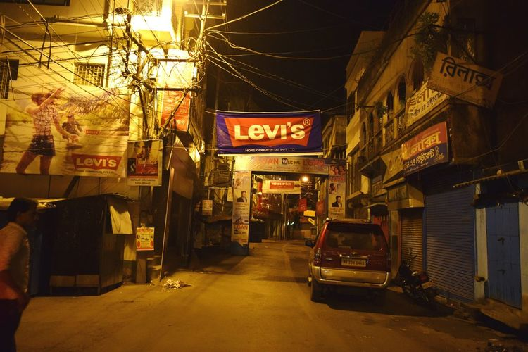 Overnight Success TakeoverContrast Architecture Building Exterior Built Structure Illuminated Night Street Road Non-western Script City The Way Forward Outdoors Commercial Sign Market Shop Narrow Brand City Street Street Night Street Photography Road Levi's at Berhampore India