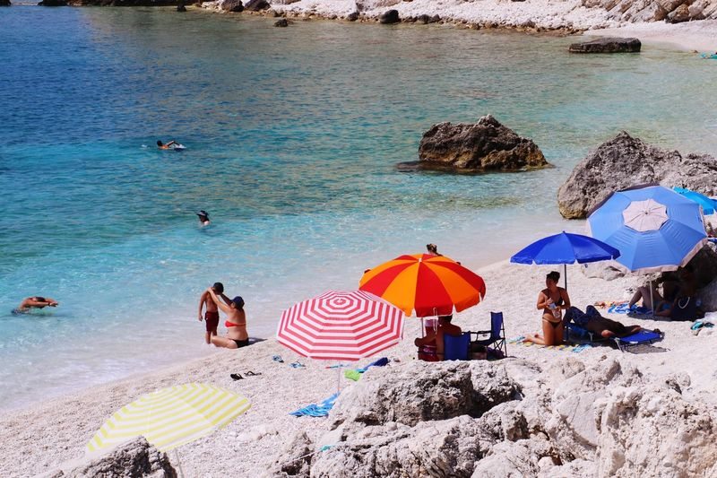 A day at the beach Seascape Beach Umbrella Beach Day Beach Life Beach Photography Beachphotography Beach Family Eyeem Photography EyeEm Gallery EyeEm Water Beach Umbrella Land Sea Parasol Group Of People Real People Leisure Activity Nature Holiday Vacations Beauty In Nature Trip Women Sand Lifestyles Summer Outdoors My Best Photo