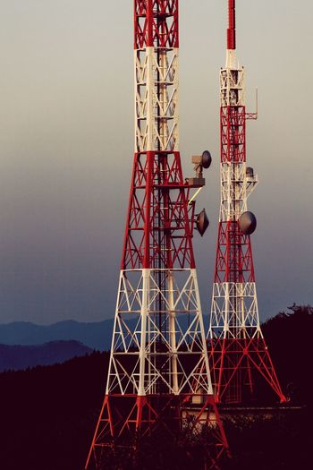 Masts with antennas at dusk