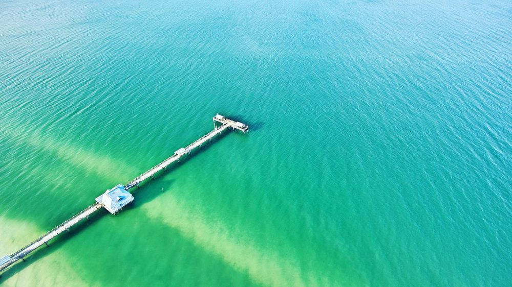 Above Clearwater, FL Water Ocean High Angle View Sea Aerial View Outdoors No People Pier Drone  Dronephotography Phantom 4 Travel Travel Destinations Travel Photography Clay Hayner Photo ClayHaynerPhoto Photo Photography Photooftheday Picoftheday Florida Clearwaterbeach Clearwater Beach, FL From Above