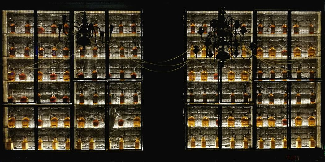 wall of whiskey Wall Whisky Bottle Bottles Collection Bottles Collection Alcohol Alcoholic Drink Alcohol Bottles Grid Shelf Vitrine Light And Shadow Light Warm Lit Row Collection Nopeople Indoors  Design Interior Design Decoration Wall - Building Feature Pattern Interior Window Full Frame Backgrounds Sky Close-up The Still Life Photographer - 2018 EyeEm Awards HUAWEI Photo Award: After Dark