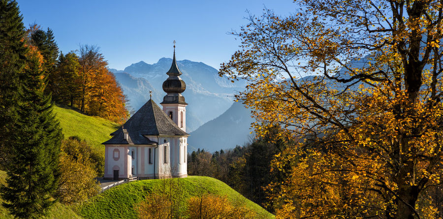 The pilgrimage church of Maria Gern near Berchtesgaden. Autumn Autumn Colors Bavaria Berchtesgadener Land  Church Architecture Autumn Beauty In Nature Berchtesgaden Building Exterior Catholicism Fall Germany Green Color Maria Gern Mountain Mountain Range Nature No People Outdoors Place Of Worship Religion Sky Spirituality Tree