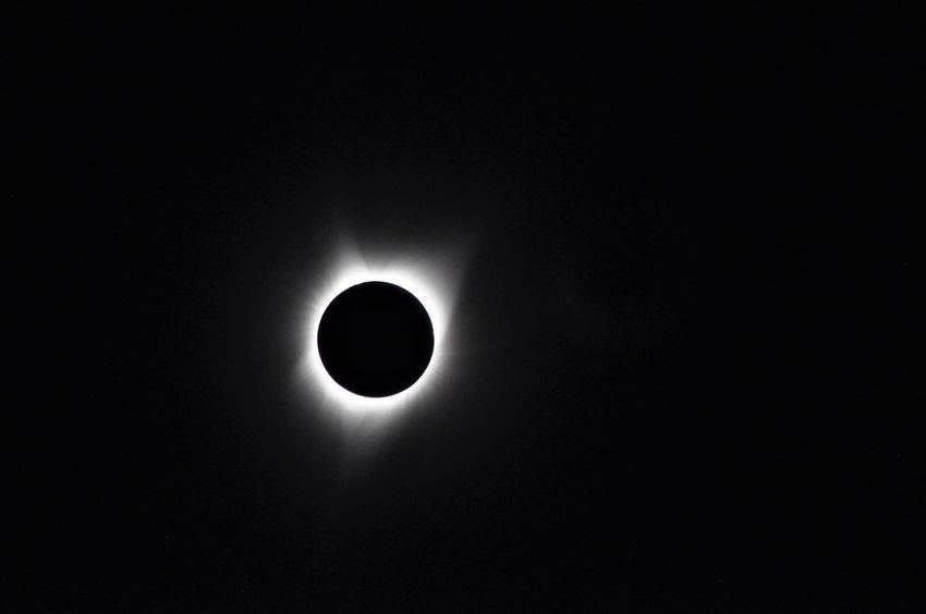 A few days late in posting this shot. Taken in Idaho. Awesome Performance Moon Sun And Moon Togheter Total Eclipse Of The Sun Astronomy Astronomy Photography Beauty In Nature Black And White Black And White Collection  Blackandwhite Photography Circle Eclipse Low Angle View Mix Yourself A Good Time Nature Silhouette Sky Solar Eclipse Space Spectacular View Spectator Sun Sun And Moon Sun And Moon Together Total Eclipse