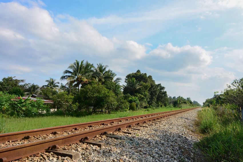 A railway in a countryside showing green scenary. Classic Countryside Iron Kampung Keretapi Landasan Kereta Nature Outdoors Rail Railroad Track Railway Rock S Steel Train Tree