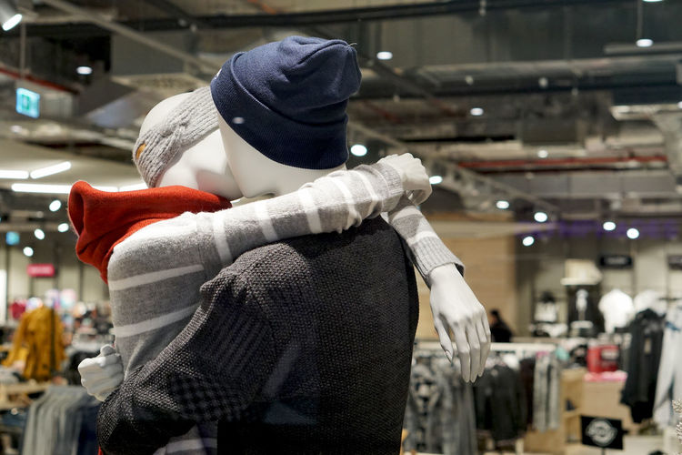 kissing puppets Clothing Focus On Foreground Indoors  Retail  Real People Store One Person Illuminated Standing Retail Display Incidental People Glove Shopping Hat Protection Winter Hanging Business Textile Warm Clothing Consumerism Obscured Face No People Kiss Kissing Symbol Puppets
