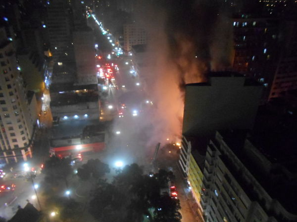 Inner City Calamity in downtown São Paulo at Largo do Paissandú; 3 am May 1, 2018. The abandoned former Federal Police steel and glass skyscraper, which had been invaded by street people, imploded this early morning and the neighboring building has caught on fire as well. Destruction Destruction Can Be Beautiful Inner City Largo Do Paissandu Largo Do Paissandu Night Photography Susan A. Case Sabir Unretouched Photography Building Fire Building Implosion City City Life Controlled Chaos Destroyed Buildings Downtown São Paulo Illuminated Implosion Night Responsiveness Smoke - Physical Structure Unexpected Event Focus On The Story