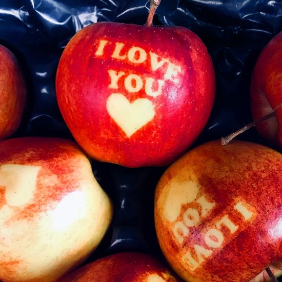 Forbidden fruit Love Iloveyou Germany Fruit Stall Market Apple Text Communication Red Full Frame Close-up No People Indoors  Day Food