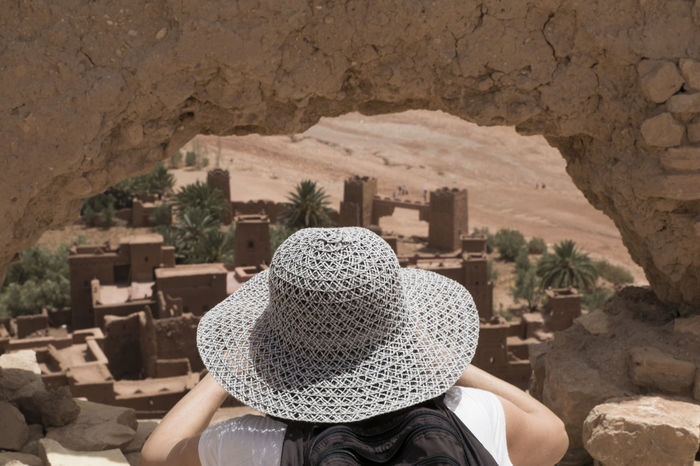 Adult Architecture Built Structure Day Leisure Activity Lifestyles Men Nature One Person Outdoors People Place Of Worship Real People Rear View Rock - Object Sun Hat Women