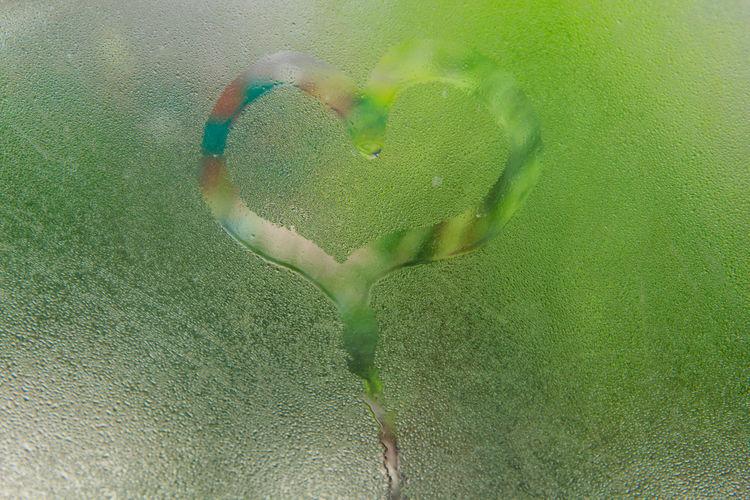 Close-up of heart shape on glass