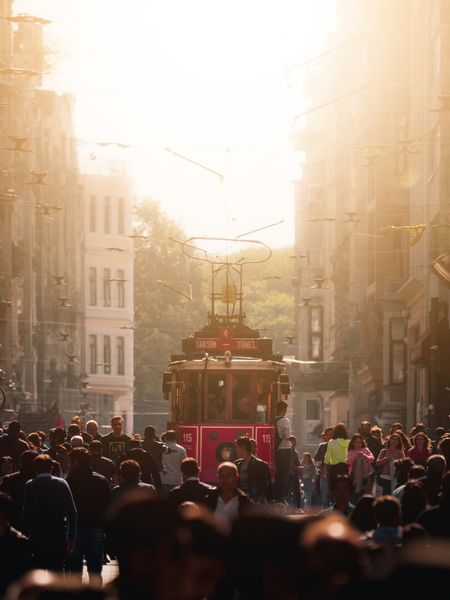 The infamous Istiklal Street in Istanbul see thousands of people move along it each day. Week On Eyeem Istanbul Istanbul Turkey Olympus Travel Istiklal Tram Sunset City Crowd Cityscape Men City Life Arts Culture And Entertainment Sunlight Cultures Parade City Street Silhouette Outline Sun Orange Color Sunrise Dramatic Sky A New Perspective On Life