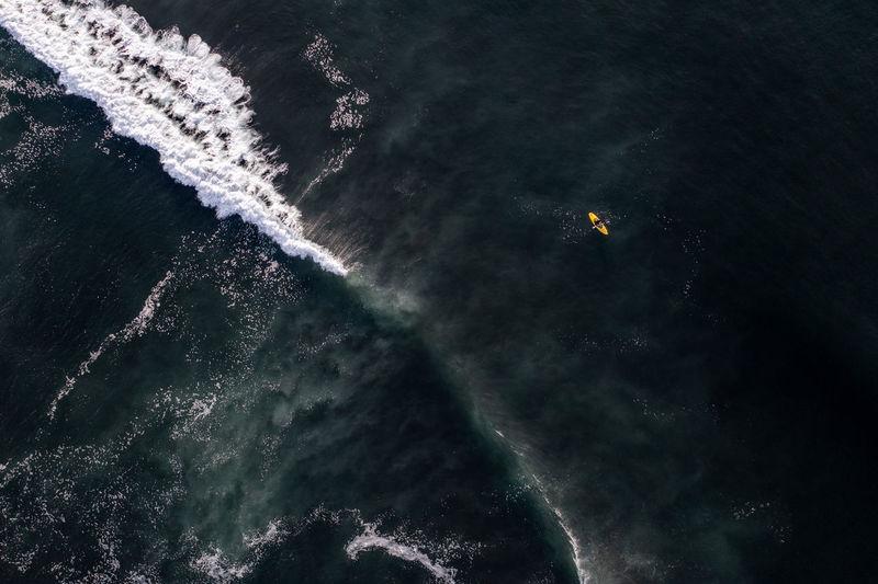 Sea kayaking in pacific ocean