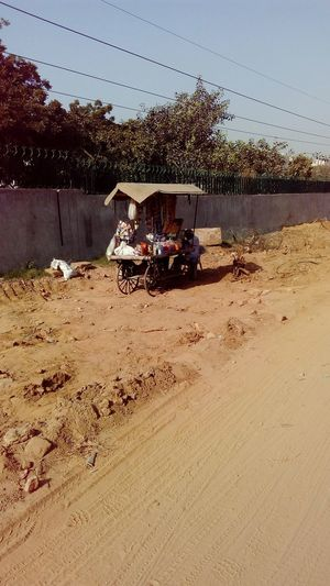 Under Construction Road Roadside Food Stall Soil Digging Yellow Yellowish green Green Sky Piece Of Land Day SSClickPics SSClickpix SSClicks A Situation Poor People Story Mobile Photography
