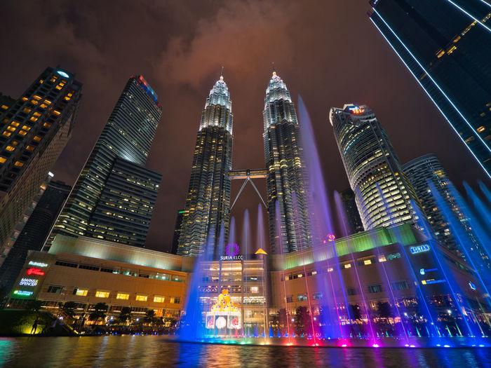 Illuminated modern buildings in city at night