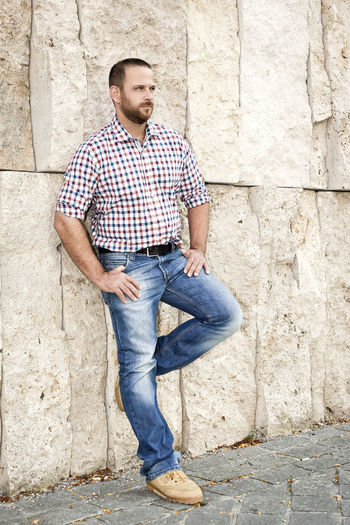 Full Length Of Man Leaning On Wall