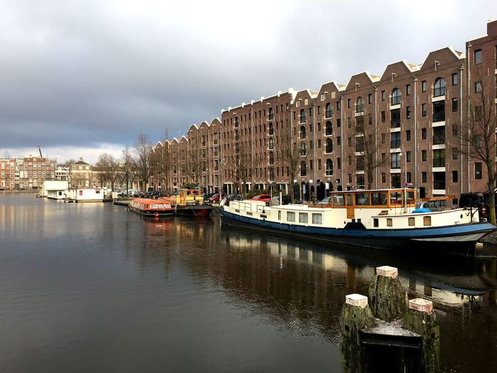 Entrepotdok in Amstetdam Frozen Canal Frost Sunny Day Houseboats In Amsterdam Old Warehouse Architecture Building Exterior Built Structure Mode Of Transport Nautical Vessel Transportation Waterfront Water Sky City No People Day Cloud - Sky Outdoors Travel Destinations Residential Building Cityscape