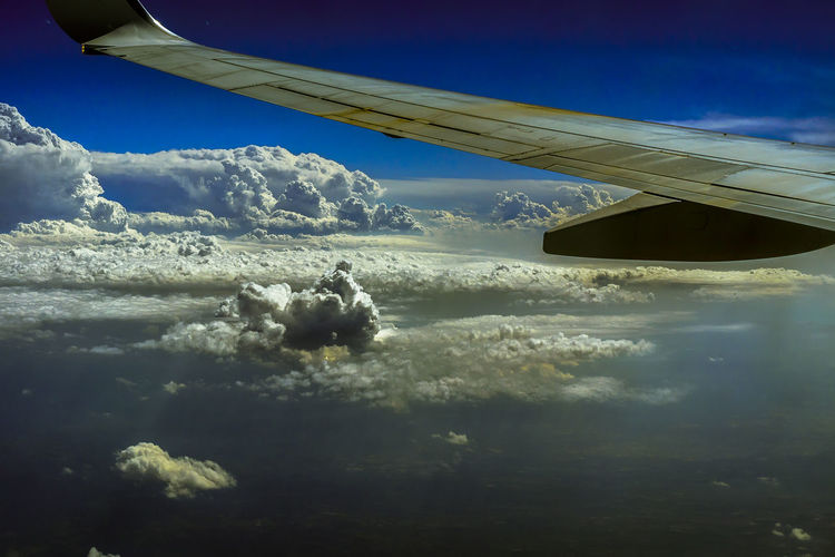 Cloud - Sky Beauty In Nature Sky Nature No People Scenics - Nature Day Aerial View Outdoors Airplane Airline Trip Journey Holiday Mode Of Transportation Transportation Air Vehicle Flying Travel Aircraft Wing Motion Mid-air Vehicle Interior Sunlight Cloud