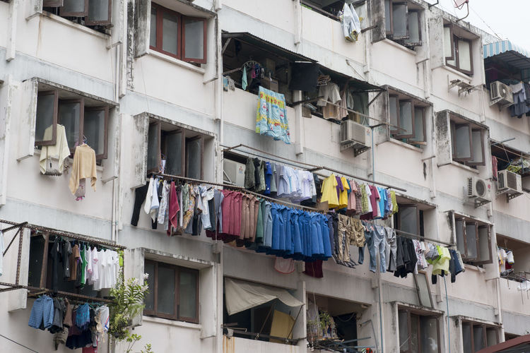 Low Angle View Of Clothes Drying Against Built Structure