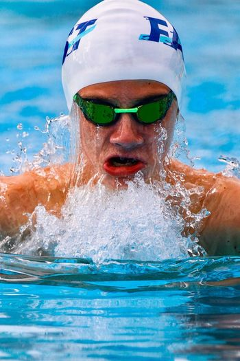 Water Swimming Pool Exercising Headshot Competition Sport Healthy Lifestyle Swimming Splashing Young Adult Men Competitive Sport Athlete Aquatic Sport Close-up Sports Training Determination Adult One Person Sportsman