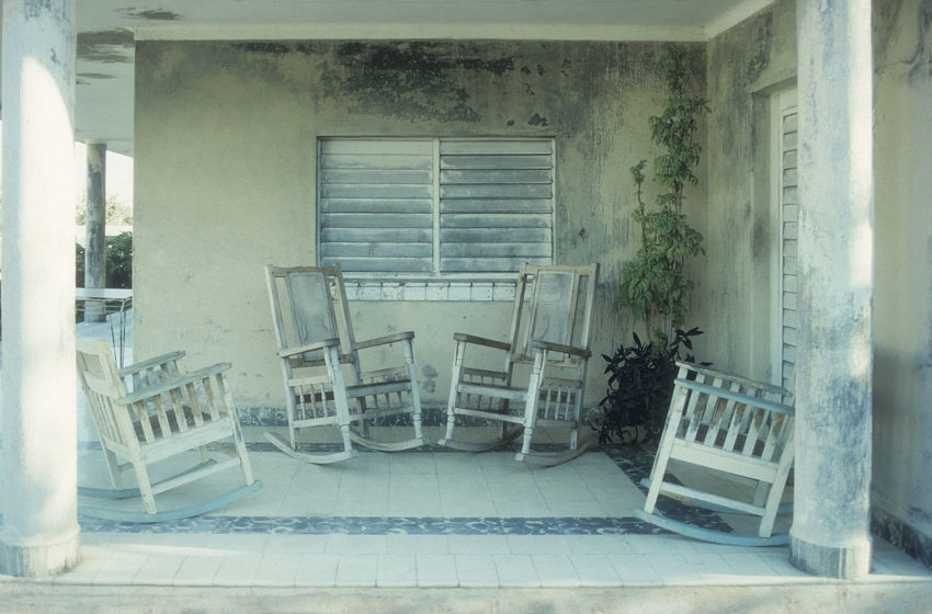 rocking chairs on terrace in silence Rocking Chair Terrace Absence Architecture Building Built Structure Caribbean Chair Day Domestic Room Door Entrance Flooring Furniture House Indoors  No People Patient Patio Furniture Rocker Seat Shabby Chic Silence Tiled Floor Transparent Vintage Wall Window