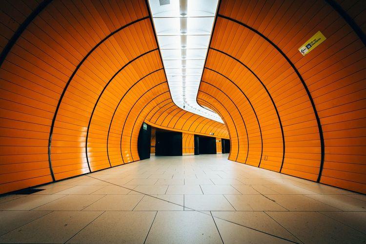 Interior of illuminated underground walkway