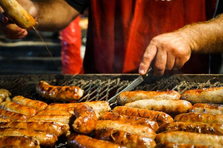 Man preparing sausage on grill