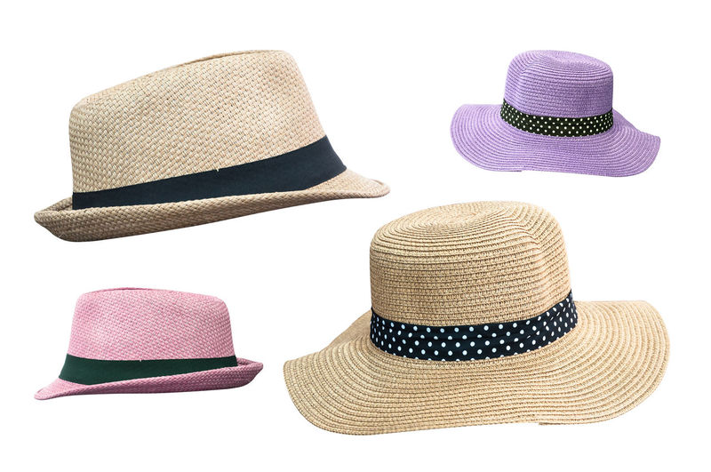 Close-up of hats against white background
