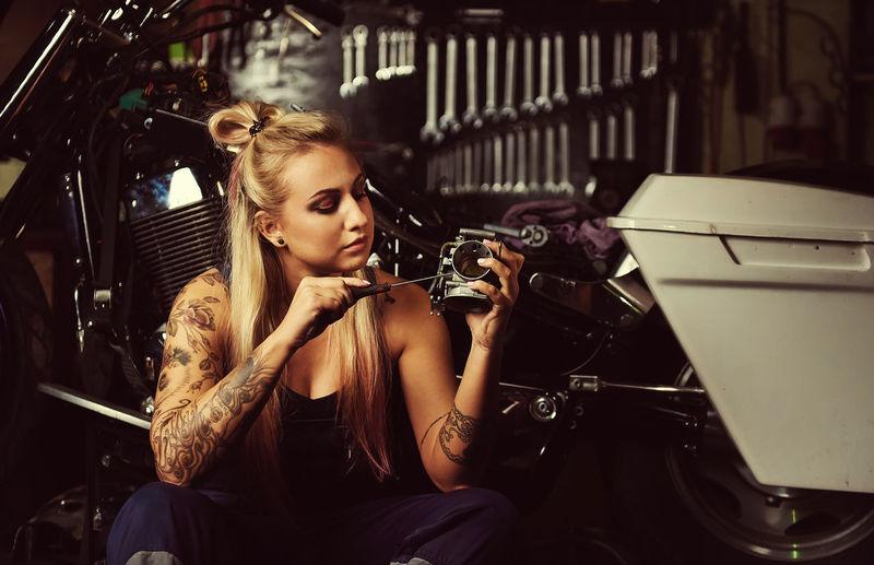 Frontal View Woman Repairing Her Motorbike