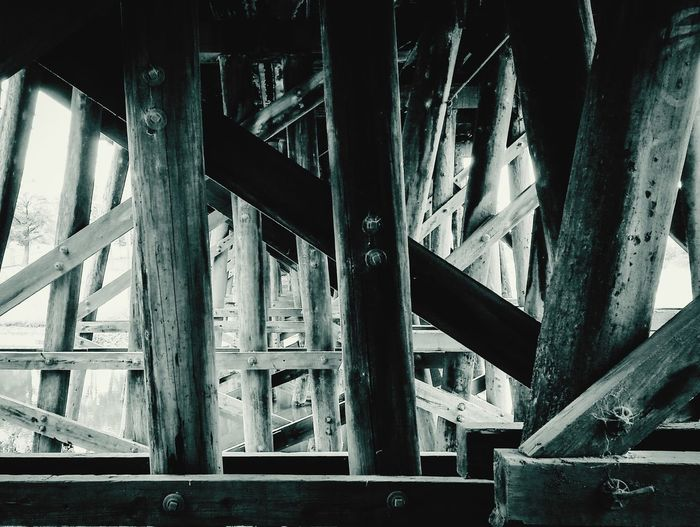 wooden framed railway bridge No People Close-up Architecture Beneath Shadow Lines Shape Urban Bridge Design Abstract Monochrome Architecture Cellphone Photography Light Simple